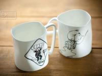 porcelianiniai puodeliai daiktu fotografija